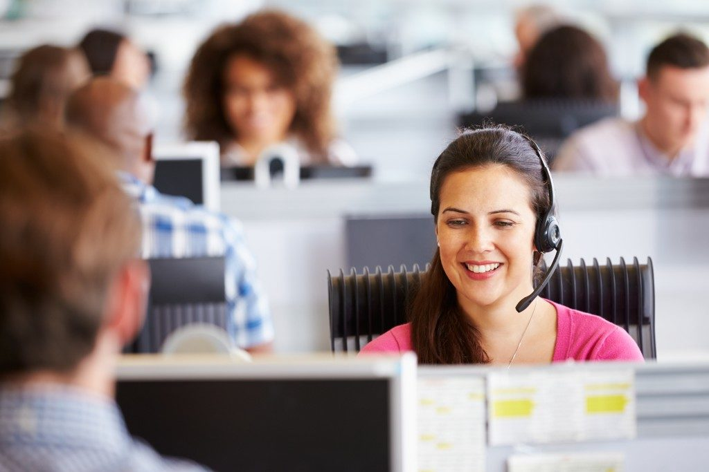 Woman working with headset on