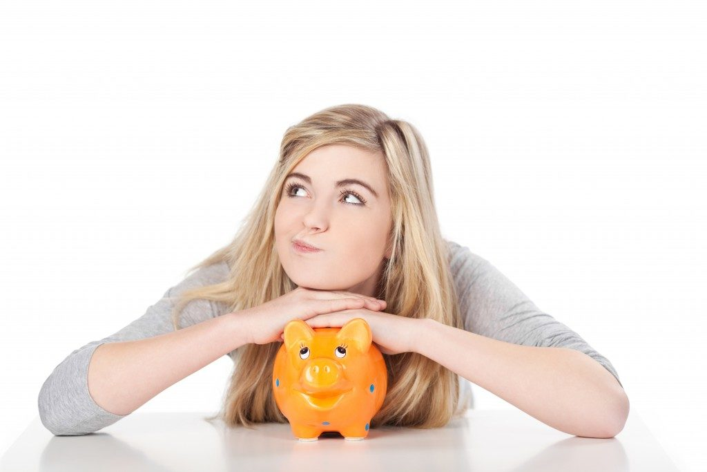 Female with her piggy bank