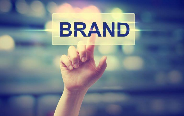 Hand pressing on brand