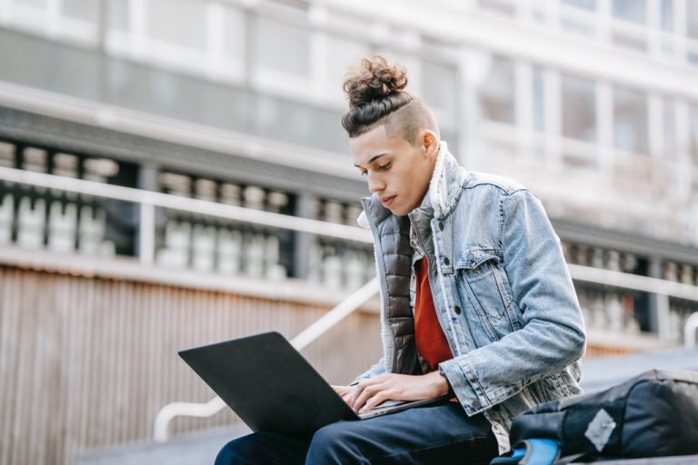 a young man using a laptop