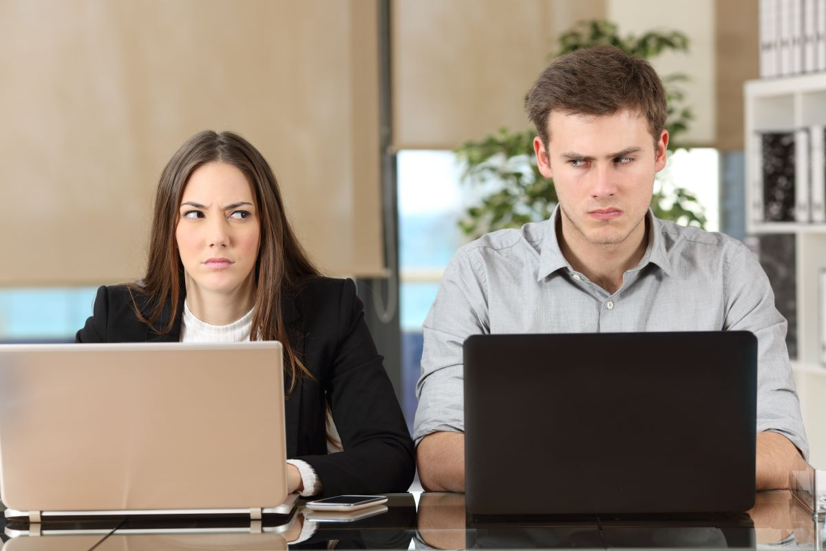 coworkers competitively looking at each other