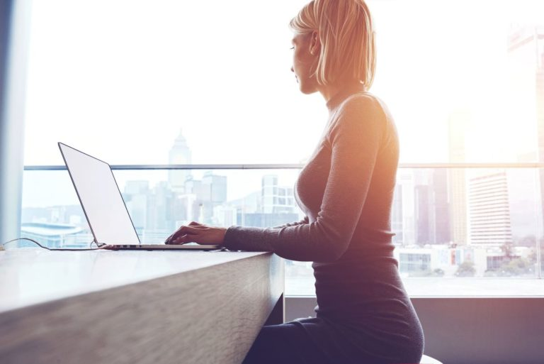 woman working remotely laptop